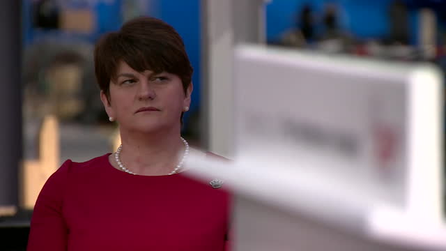 blurred focus on dup leader arlene foster as she sits next to a lectern - defocussed stock videos & royalty-free footage