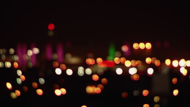 blurred lights at the los angeles international airport at night. - defocussed stock videos & royalty-free footage