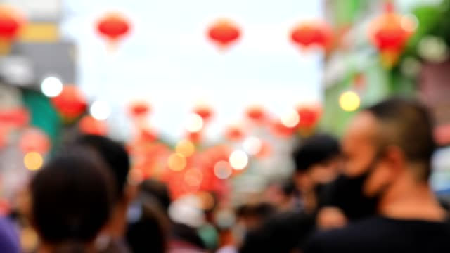 blurred market street decorated with chinese lantern with unrecognized people wear protective mask. - beijing stock videos & royalty-free footage