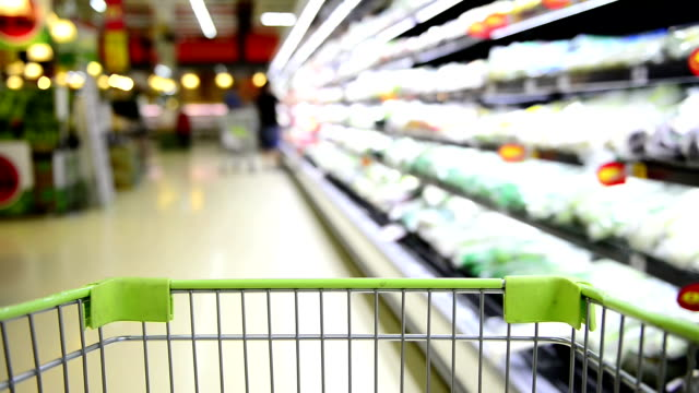 hd blurred motion grocery cart in the supermarket - trolley stock videos and b-roll footage