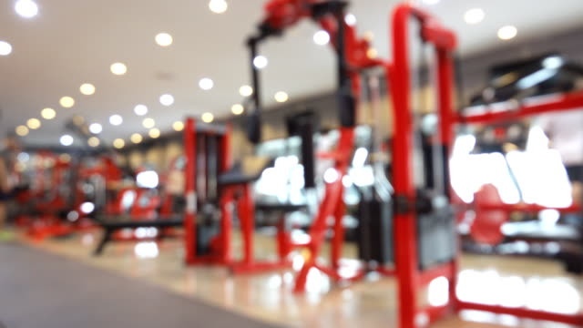 blurred motion in a gym with bokeh - lateral pull down weights stock videos & royalty-free footage