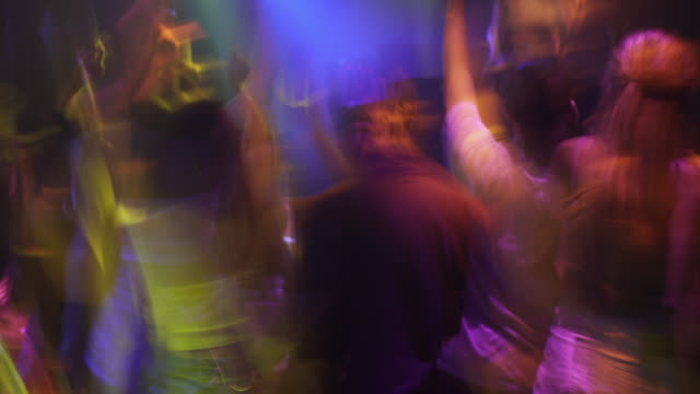 blurred motion of people dancing and cheering in club during party,slow motion - disco dancing stock videos & royalty-free footage