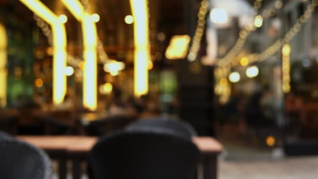 blurred motion of people in restaurant blur background - vehicle interior stock videos & royalty-free footage