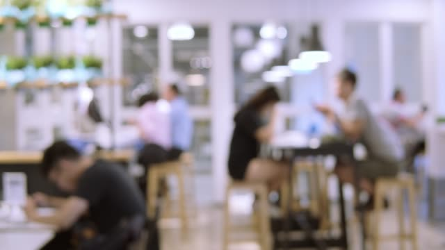 blurred motion of people in restaurant blur background - office stock videos & royalty-free footage