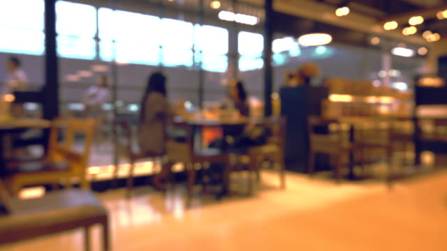 blurred motion of people in restaurant blur background - defocussed stock videos & royalty-free footage