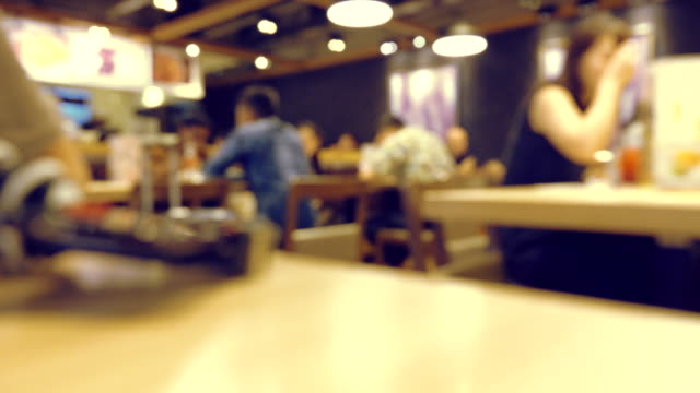 blurred motion of people in restaurant blur background - menu stock videos & royalty-free footage