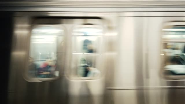 blurred motion of subway train - stazione della metropolitana video stock e b–roll