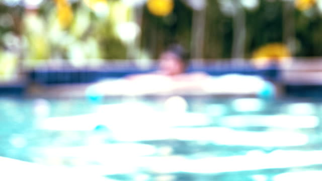 blurred motion of woman in swimming pool - girls wearing see through clothes stock videos and b-roll footage
