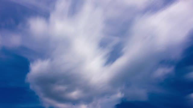 blurred motion white clouds 4k - ozone layer stock videos & royalty-free footage