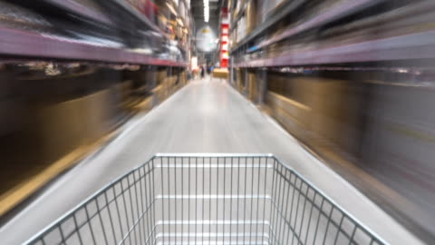 blurred motion with shopping in supermarket by trolley. timelapse 4k hyperlapse - shelf stock videos & royalty-free footage