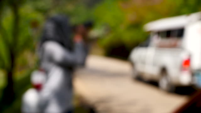 blurred of woman photographs view in side rural road - fashion photography stock videos & royalty-free footage