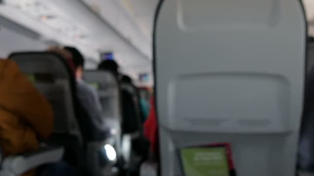 blurred passenger cabin interior from a seat - abitacolo video stock e b–roll