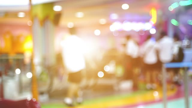 blurred people in motion, people walking in shopping center, out of focus movie shot - sale stock videos & royalty-free footage
