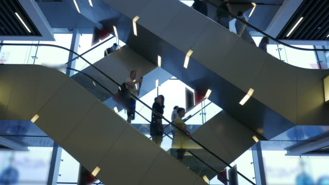 Blurred people on a escalator