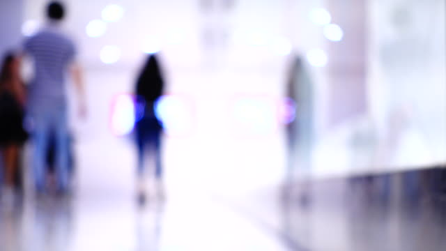 blurred people walking in shopping center - motion stock videos & royalty-free footage