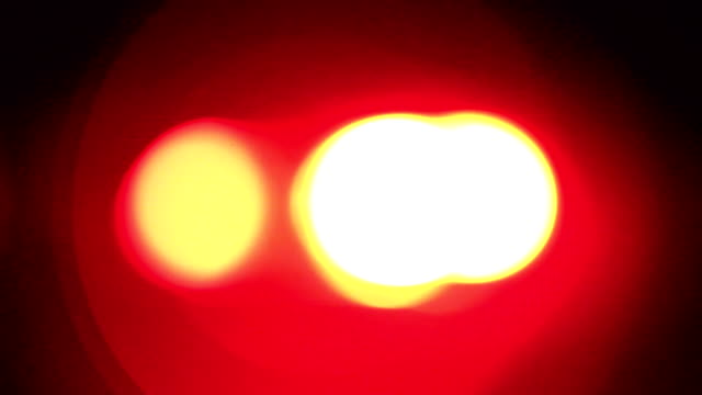 blurred red & blue police sirens / flashing lights - siren stock videos & royalty-free footage