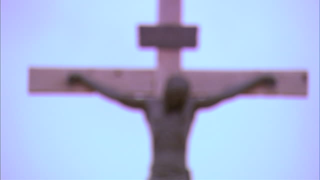 blurred statue of Christ on cross