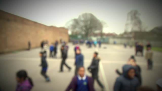 blurred view of children playing in a school - playground stock videos & royalty-free footage