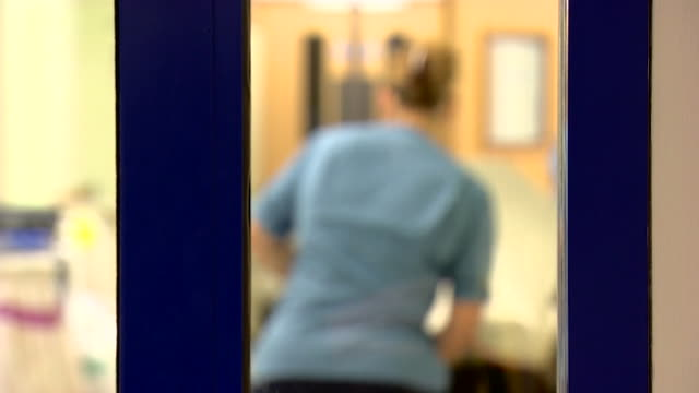 blurred view of nhs nurses fixing a hospital bed - blurred motion stock videos & royalty-free footage