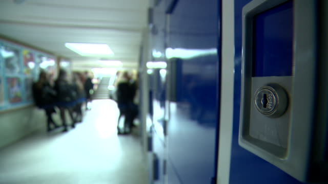 blurred view of pupils in a secondary school corridor - secondary school child stock videos & royalty-free footage