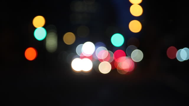 Blurry colorful city lights blinking
