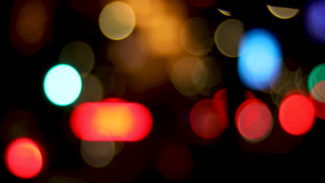 blurry lights in the night - road signal stock videos & royalty-free footage
