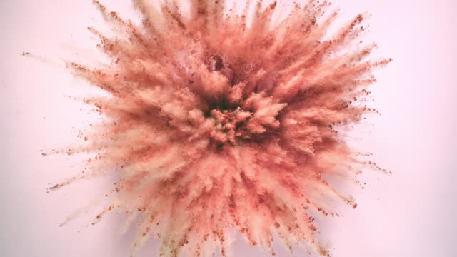 vídeos y material grabado en eventos de stock de blush pink colored powder exploding towards camera in close up and super slow-motion, light pink background - maquillaje