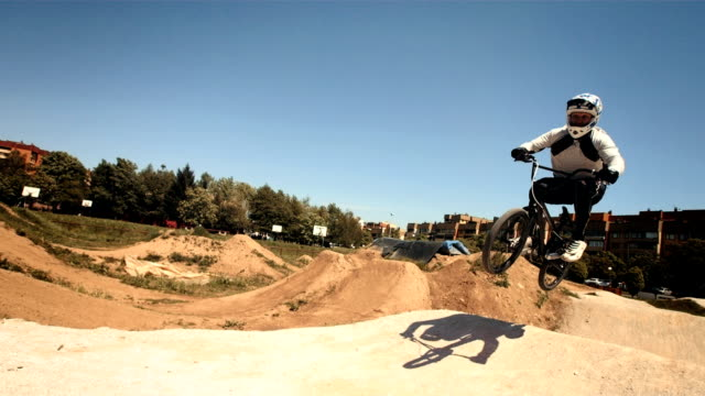 HD SLOW MOTION: Bmx Rider Racing On The Track