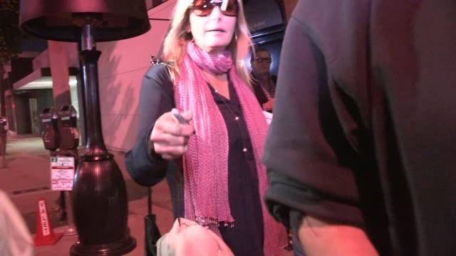 vídeos de stock e filmes b-roll de bo derek greets fans while departing from craig's in west hollywood on april 16 2014 in los angeles california - bo derek