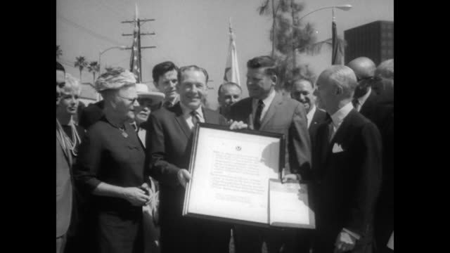 mca board chairman jules stein shakes hands with mayor sam yorty during a formal presentation of a beautified thoroughfare to the city of los angeles... - plakette stock-videos und b-roll-filmmaterial