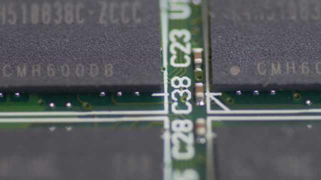 PCB Board Microcircuit Close up by Macro lens , Sliding by dolly