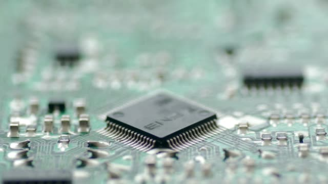 pcb board microcircuit close up by macro lens , sliding by dolly - conductor stock videos & royalty-free footage