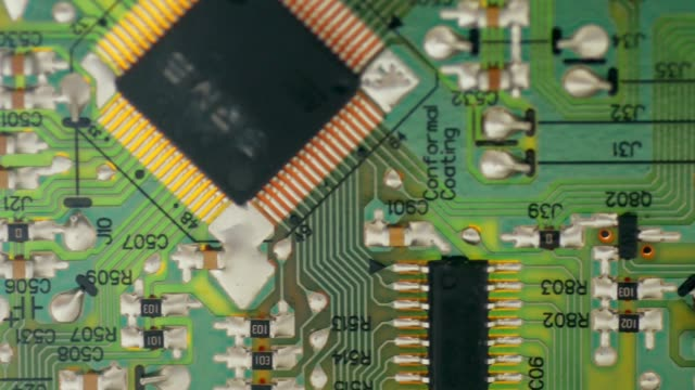 pcb board microcircuit close up by macro lens , sliding by dolly - computer chip stock videos & royalty-free footage