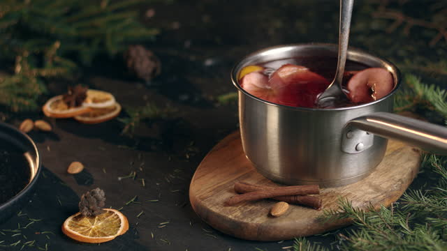 a board with a ladle of mulled wine on it - scented stock videos & royalty-free footage