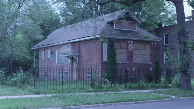 WS Boarded up brick house night