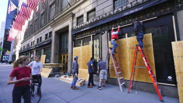 boarded up the show windows for prevention from mob violence of george floyd death protesters at midtown manhattan new york city ny usa on may 31... - barricade stock videos & royalty-free footage
