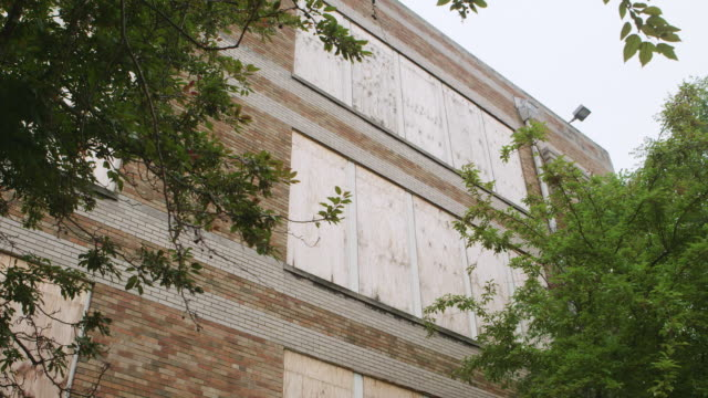 MS TU Boarded up windows at abandoned elementary school