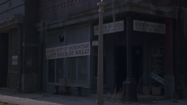 boarded-up stores line a dirt road. - western script stock videos & royalty-free footage