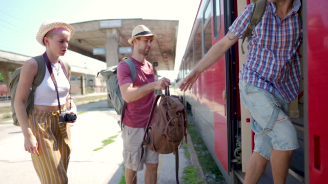 boarding the train - stazione video stock e b–roll