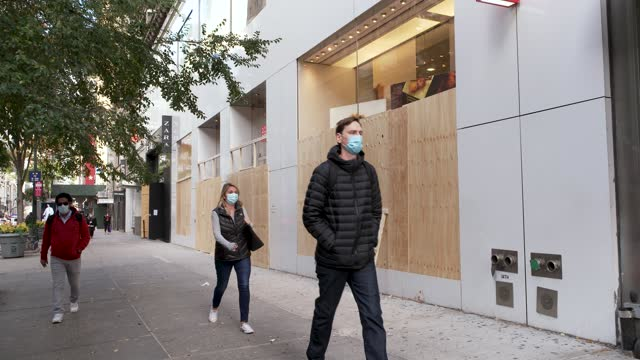 boarding up store fronts in herald square in midtown manhattan in anticipation of civil unrest during the us presidential elections on november 3,... - facade stock videos & royalty-free footage