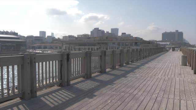 boardwalk and cafes in old tel aviv port area, tel aviv, israel, middle east - walking point of view stock videos and b-roll footage