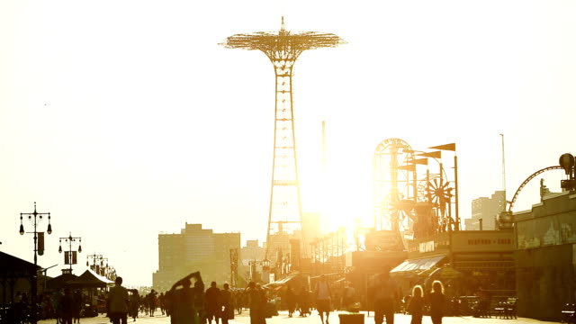 boardwalk at sunset in coney island - coney island brooklyn stock videos & royalty-free footage