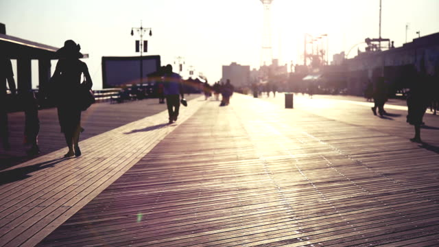 boardwalk at sunset in coney island - timber stock videos & royalty-free footage