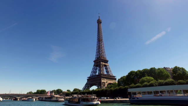 Boat along the Seine river with Eiffel tower in Paris