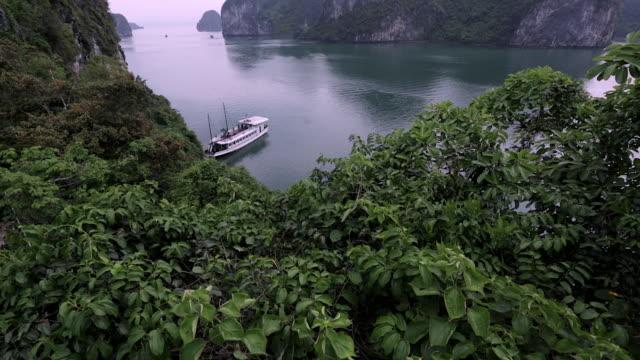 ws ha tu boat anchored in bay / ha long bay, vietnam - anchored stock videos & royalty-free footage