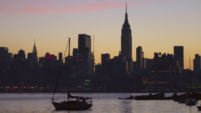 boat anchored in the hudson river overlooking the manhattan skyline - anchored stock videos & royalty-free footage