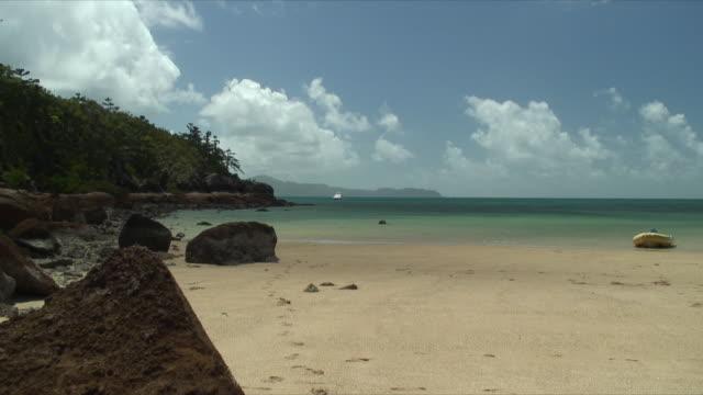 WS ZI MS Boat anchored near coast, Whitsunday Islands, Queensland, Australia