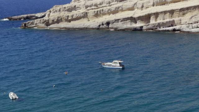 Boat and Kayak on Matala Beach on Crete, Greece