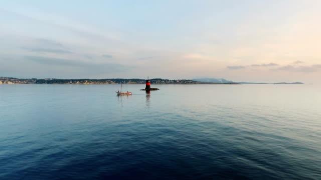 vidéos et rushes de boat and lighthouse in the bay of bandol, var, provence, france - var
