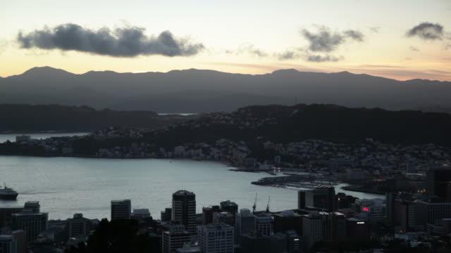 Boat arriving during sunrise, Wellington, New Zealand